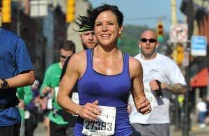 Melissa running a Half Marathon